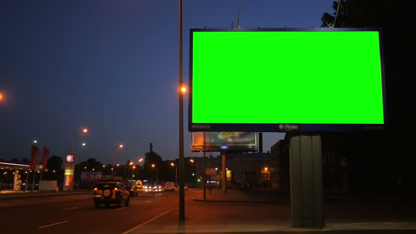 A Billboard with a Green Screen on a Busy Night Street | Shutterstock HD Video #17808580