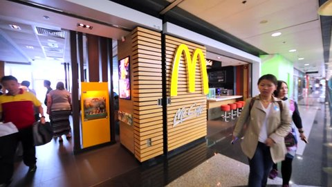 HONG KONG, CHINA - MARCH 31, 2016: McCafe in Hong Kong mall. McDonald's is the world's largest chain of hamburger fast food restaurants, serving around 68 million customers daily in 119 countries