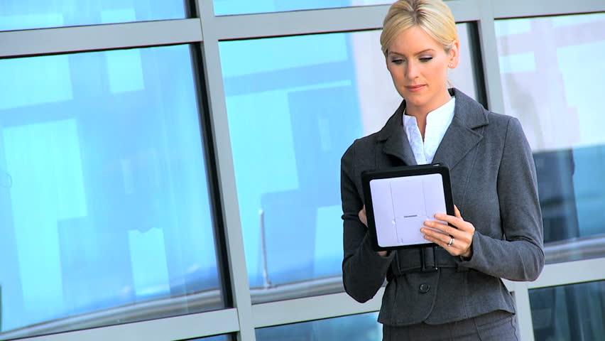 Two Businesswomen Using Wireless Technology Outdoors   Shutterstock HD Video #1781798