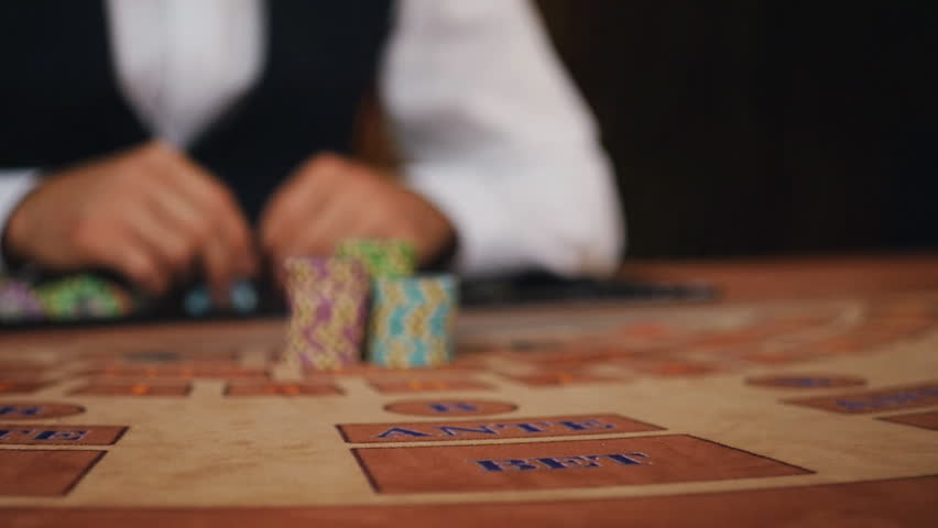 Luck smiled player. The dealer moves the player's winnings   Shutterstock HD Video #17818447