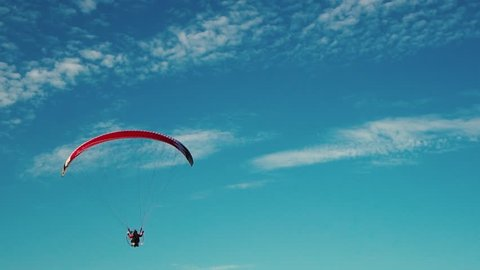 hang glider flying over a field