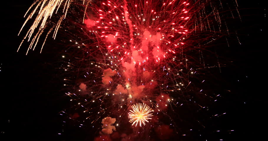 MORONI, UTAH - 4 JUL 2016: Celebration fireworks holiday 4th July. Fourth of July holiday colorful and brilliant fireworks into sky. Family fun watching aerial art. Dark night event rural community.