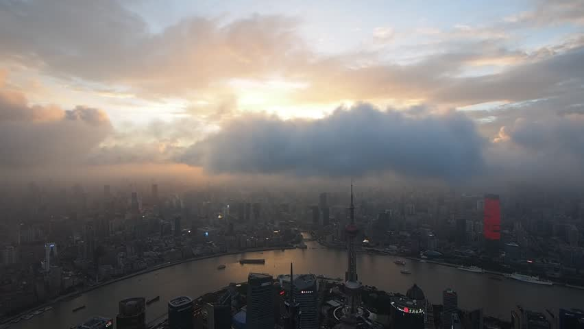 SHANGHAI, CHINA - JULY 7, 2016: Shanghai Skyline at Sunset over Oriental Pearl Tower and Huangpu River.    Shutterstock HD Video #17872828