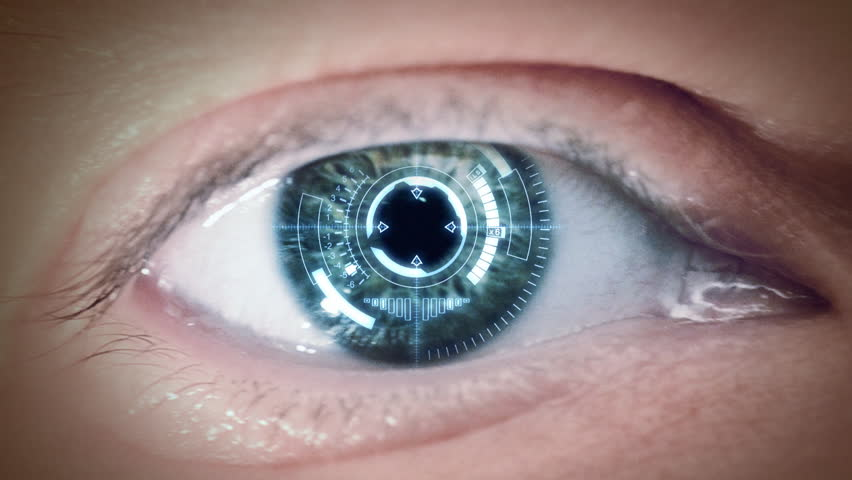 Close up to eyeball with futuristic targeting system. Loop.