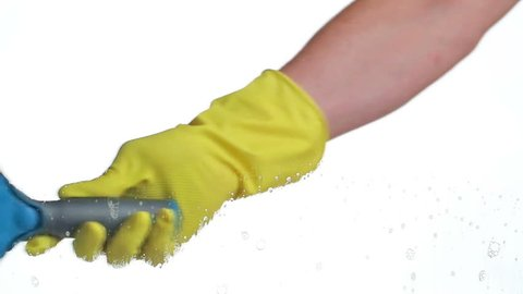 Man with rubber glove wipes cleaning detergent with small squeegee from window - housekeeping or cleaning industry concept