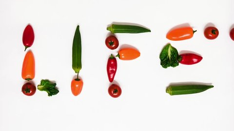 Vegetable words appearing and disappearing: LIFE, ECO, LOVE, BIO, FIT, SLIM. Beating heart at the end of the clip. Stop motion animation on white background. 4K resolution