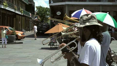 New Orleans, Louisiana - July 7th 2016 - Jazz street performers playing for a crowd in Jackson Square in the French Quarter, New Orleans.