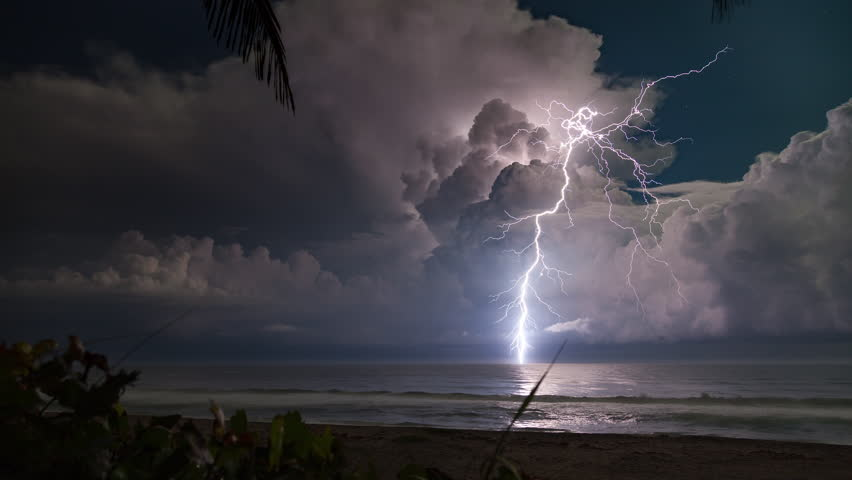 4K-UHD - Extreme lightning storm timelapse over the moonlit Florida ocean at night. | Shutterstock HD Video #17938501