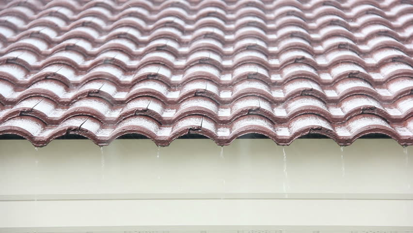 Falling Rain Drop On Brown Brick Roof.   HD Stock Footage Clip