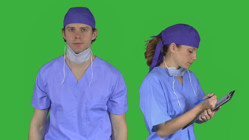Two serious doctors face the camera on a green key | Shutterstock HD Video #17969188