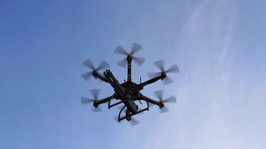 Drone Hexacopter armed with minigun flying in the sky | Shutterstock HD Video #18000508
