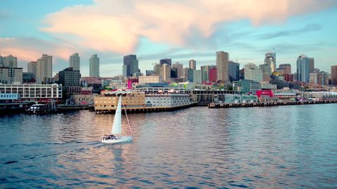 Sailboat crosses water by Seattle skyline 2