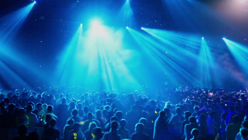Crowd At Rave Party People Dance In Blue Light Of