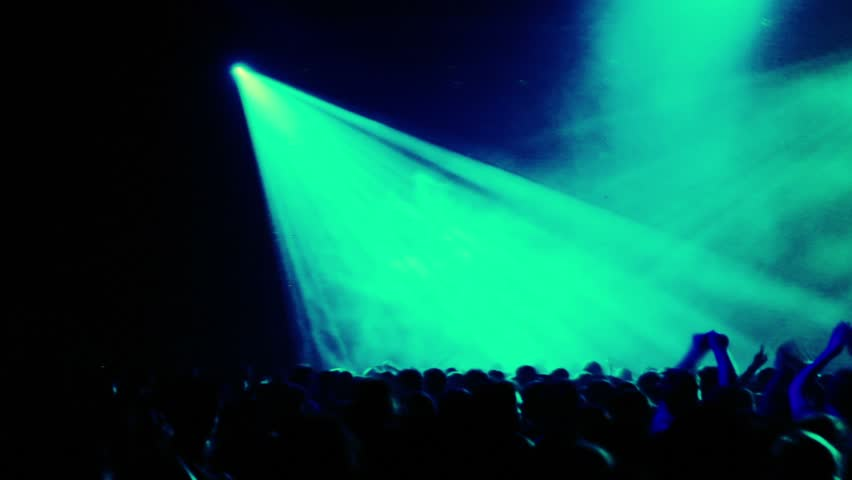 Lot of people at rave party, view from behind, hand and heads, projector pink blue color light rays #1802348