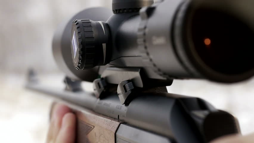 stock footage hunter with rifle with telescopic sight