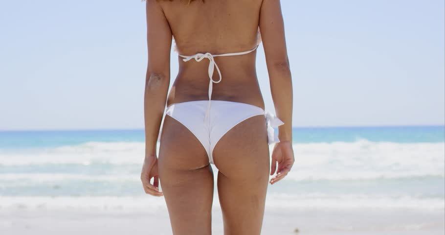 4bfb38c496e Rear view of a sexy young woman in a bikini | Shutterstock HD Video  #18044788
