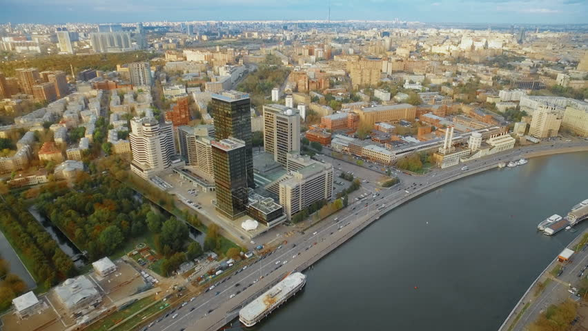 Helicopter flying over embankment of the Moskva River, the international business center and business center Moscow City.