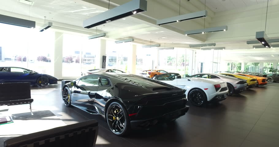 new thenewsmarket first exterior in opens design car bristol lamborghini dealer night corporate dealership s by global com