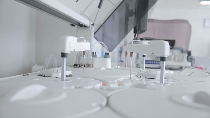 Automated pharmaceutical, medical equipment works in modern laboratory.
