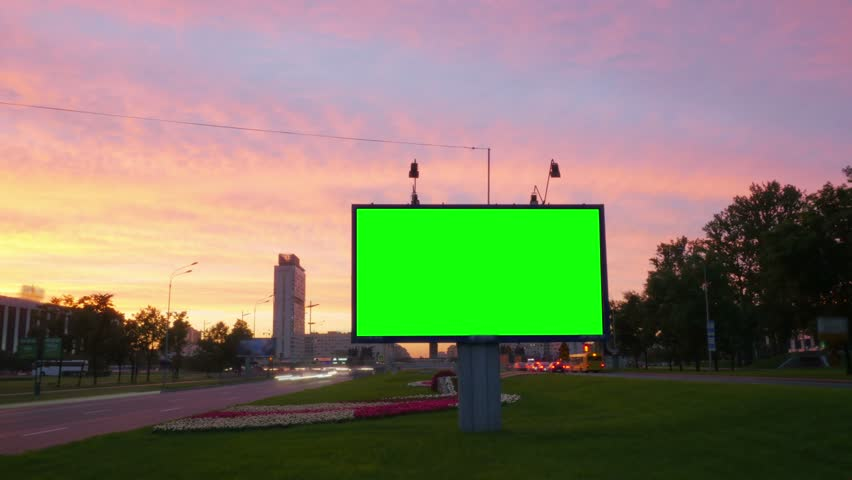 A Billboard with a Green Screen on a Busy Street.Time Lapse.