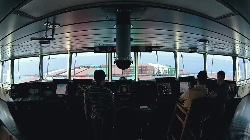 Modern ship bridge view during arrival to port.