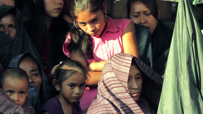 TLAMACAZAPA, MEXICO - CIRCA 2011: Women and children in traditional dress participate in anniversary celebration of the old village circa 2011 in Tlamacazapa, Mexico. Tlamacazapa is an Indigenous village in the Mexican state of Guerrero.