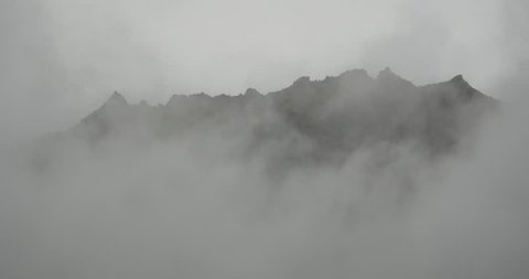 4k mountain mist rising in the morning,fog pine trees,such as wonderland.Bomi County in tibet,the largest precipitation area in China. gh2_09888_4k