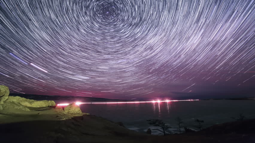 Starry night over the island Olkhon. Burkhan Cape, Olkhon island, Lake Baikal, Irkutsk region, Russia. Full HD
