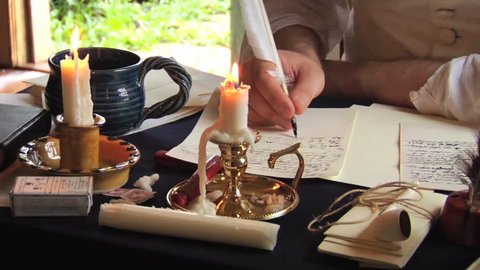 VIRGINIA - OCTOBER 2014 - Reenactment, Founding Fathers, American Revolutionary War era recreation -- Documents, Tabletop, quill writing, dipping ink and writing by candle light & by window, papers.