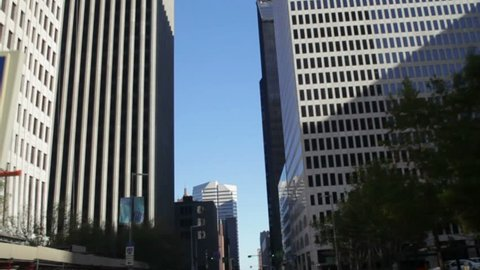 A view from below at the huge corporate office buildings that line the streets of downtown Houston Texas.