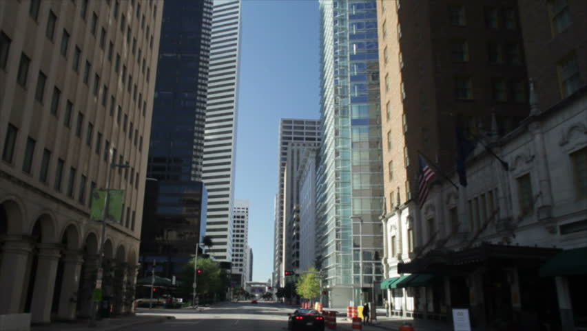 A skyward perspective of the skyscrapers in downtown Houston Texas when driving through the city.
