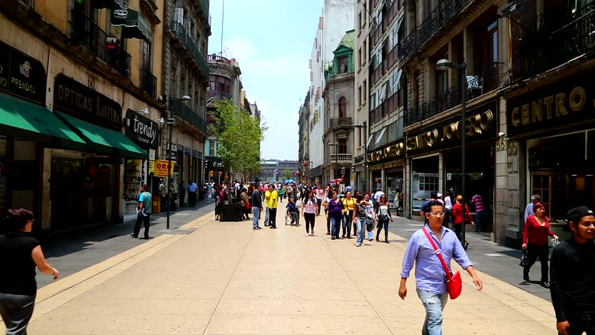 Mexico City/Mexico, June 15.  View from the street of buildings and people walking  at the Mexico City's downtown.