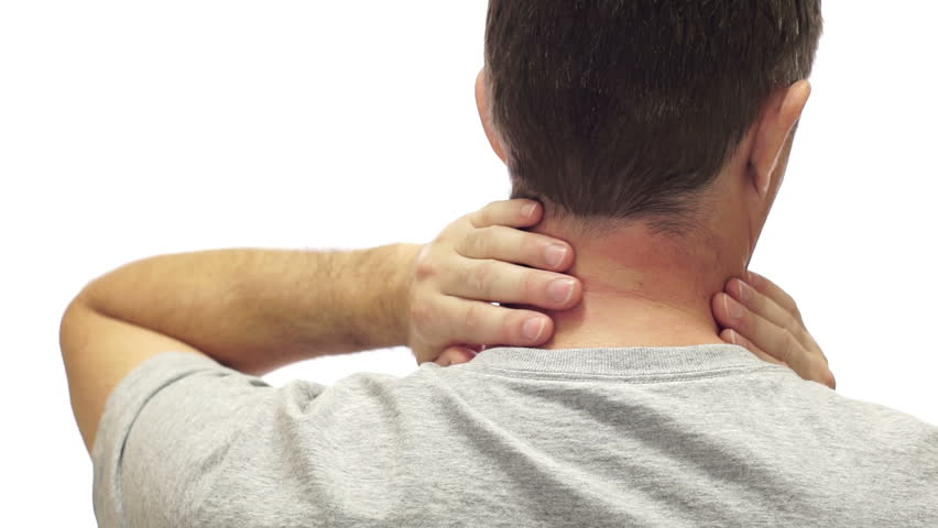 Closeup of the back of a man isolated on a white background and rubbing his sore and painful neck and neck muscles.