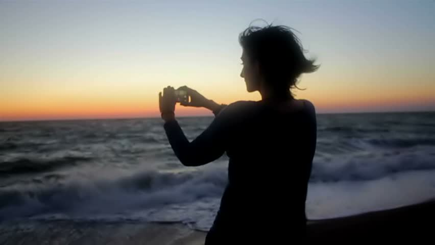 Woman taking photo on the beach. Handheld shot   Shutterstock HD Video #18276949