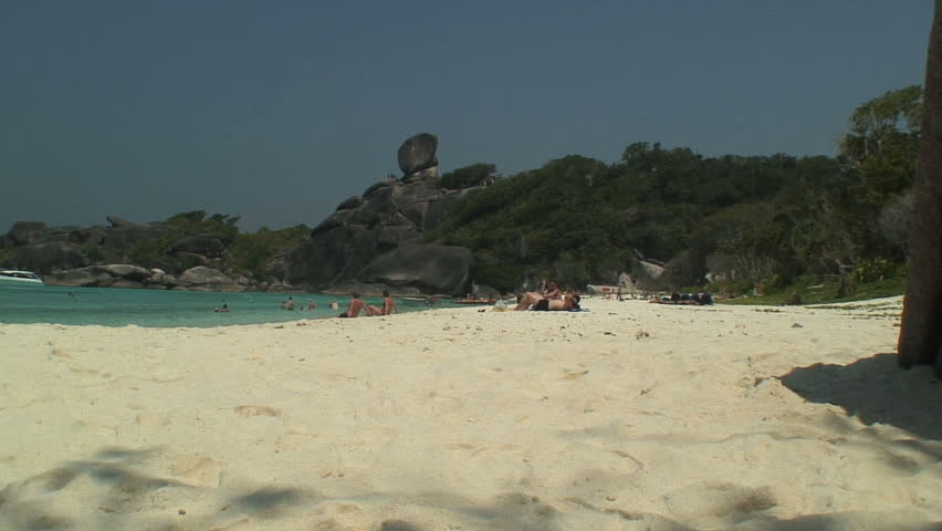 SIMILAN ISLANDS, THAILAND - FEBRUARY 3, 2007: Boulder Over Beach and Beachers