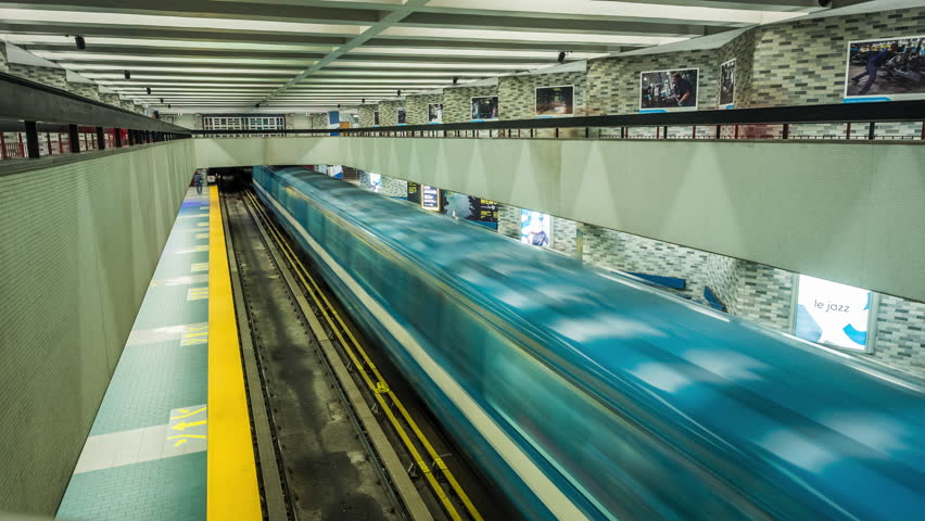 Time lapse view of trains arriving and departing from subway station in Montreal, Quebec, Canada.