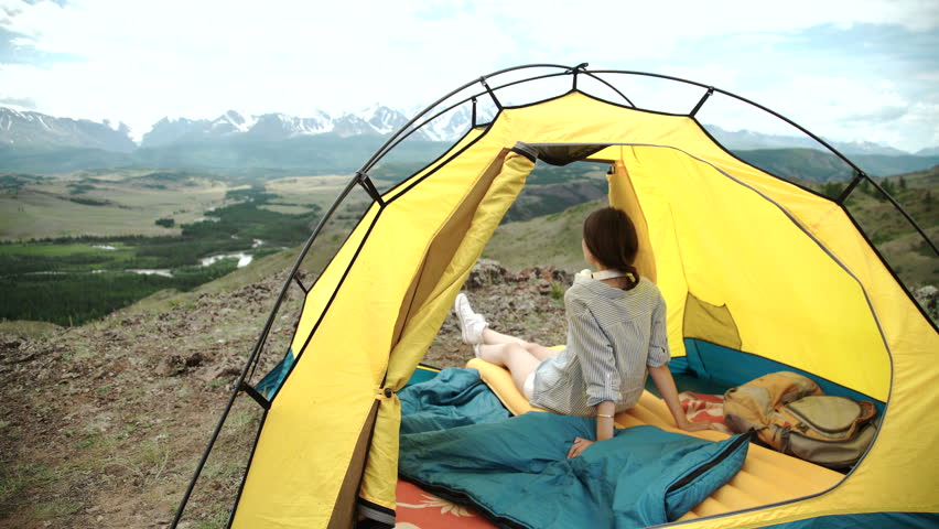 Happy woman sitting in a tent view of mountains - 4K stock video clip & Happy Woman Sitting In A Tent view Of Mountains Stock Footage ...