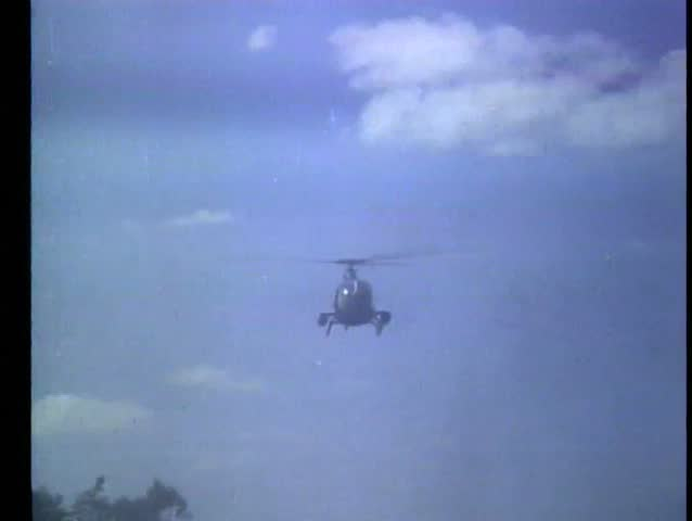 Helicopter firing missile into grove