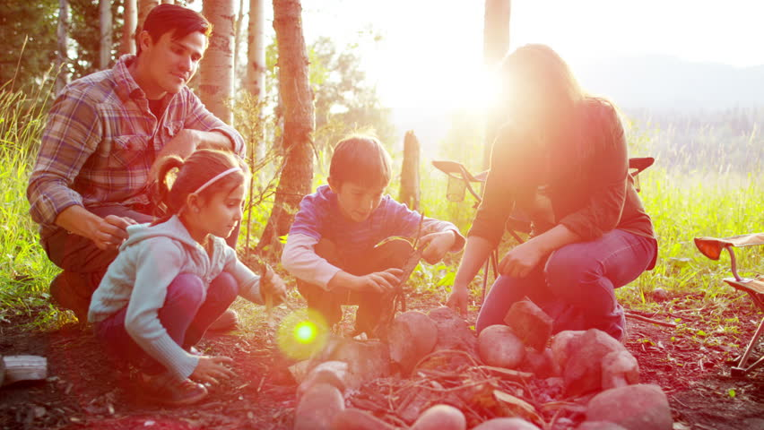 Portrait of Caucasian family enjoying camping in forest on vacation outdoors   Shutterstock HD Video #18305626