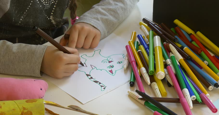 The Girl Draws a Picture by Means of Multi-Colored Felt-Tip Pens, Markers and Pencils at a Drawing Lesson in a Kindergarten. Girl Draws a Tabby Cat. Near to Her There Are Other Children Who Also Draw | Shutterstock HD Video #18331333