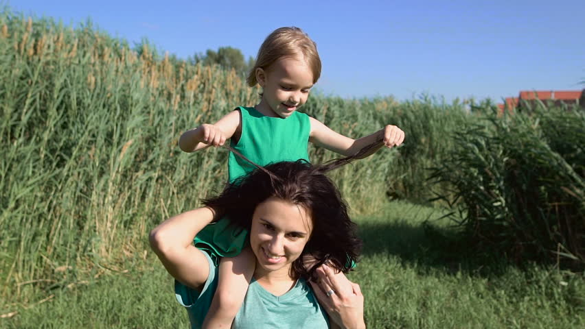 Happy daughter and mother enjoying outdoors. | Shutterstock HD Video #18343348