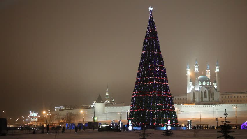 New Year's central Christmas tree near Kazan Kremlin with the view on Kul Sharif Mosque and Soyembika Tower.