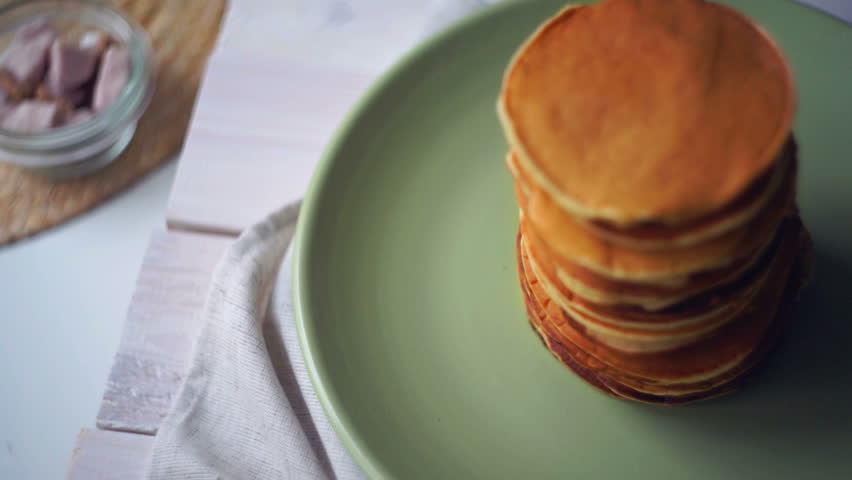 Girl make pancakes on frying pan breakfast in the kitchen put the american pancakes on plate high stack of golden pancakes baked for morning breakfast top ccuart Image collections