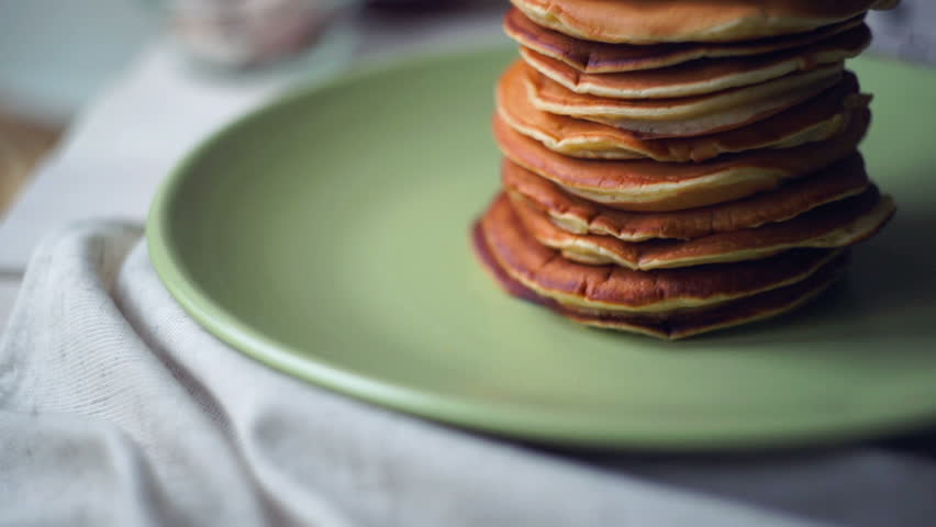 American pancakes panning on pancakes stack on green plate at pancake breakfast at morning closeup of fresh homemade dessert food at pancakes day stock footage video 18493528 shutterstock ccuart Choice Image