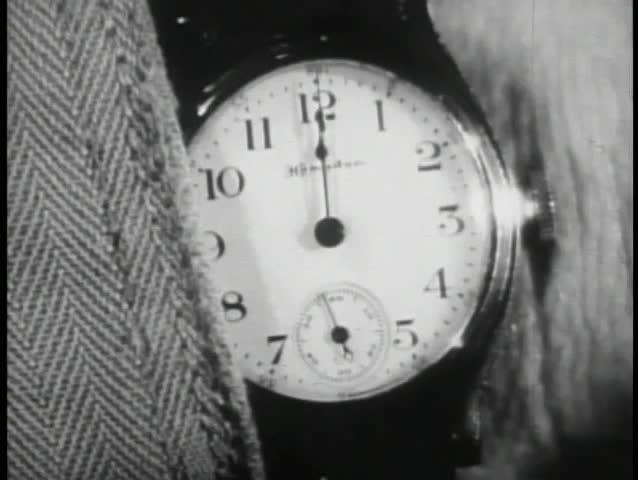 Close-up of watch face at 12 o'clock