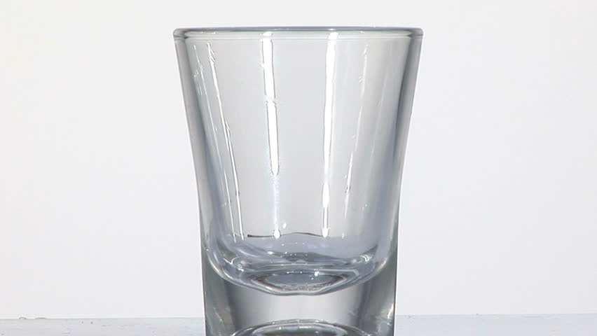 pouring drinks on shot glass