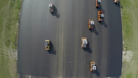 Aerial view of asphalt rollers at airport taxiway rehabilitation - Top View