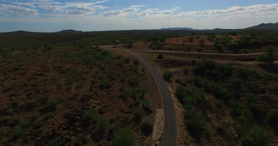 Aerial view drone footage of Namibian highland, Oanob Lake Resort and savanna, lake and gravel roads landscape with rocky background near Rehoboth in Namibia's Khomas Hochland   Shutterstock HD Video #18583808