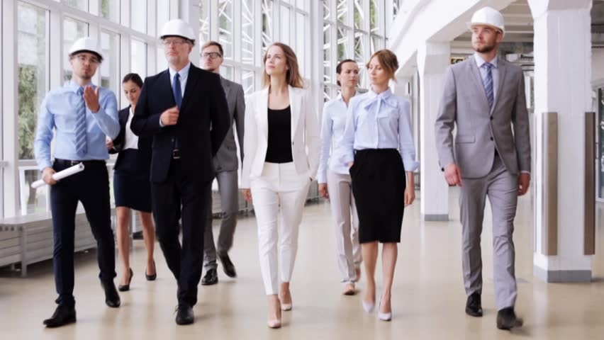 group of young business people going to meeting  walking through airport lobby  sequence  stock
