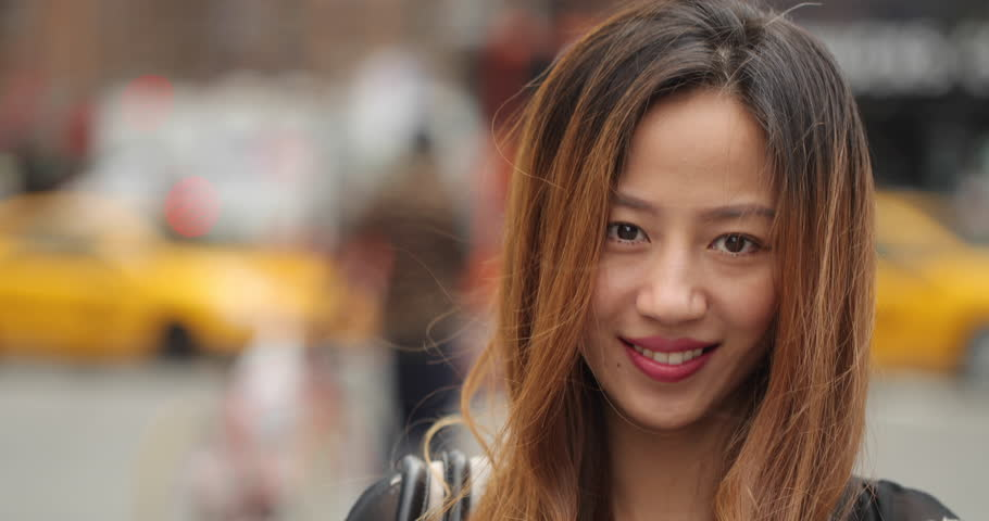 Young Asian woman in city smile face portrait | Shutterstock HD Video #18633848